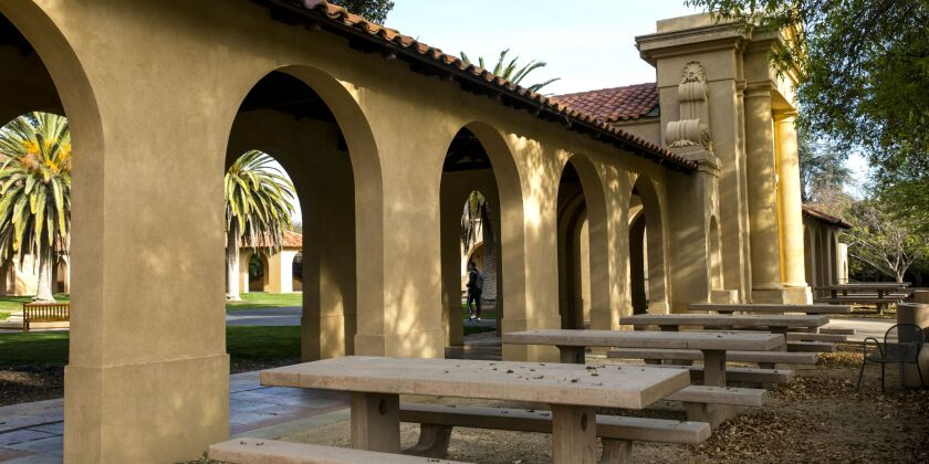 Empty chairs and tables sit outside the usually bustling student union at Stanford University.