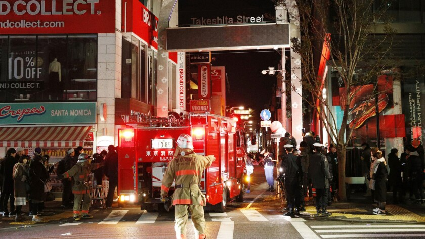 Police and firefighters inspect the site of a car attack near Takeshita Street in Tokyo early Jan. 1, 2019. A car slammed into pedestrians on a street where people had gathered for New Year's festivities.