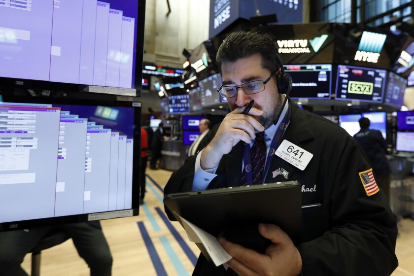 Trader Michael Capolino works on the floor of the New York Stock Exchange