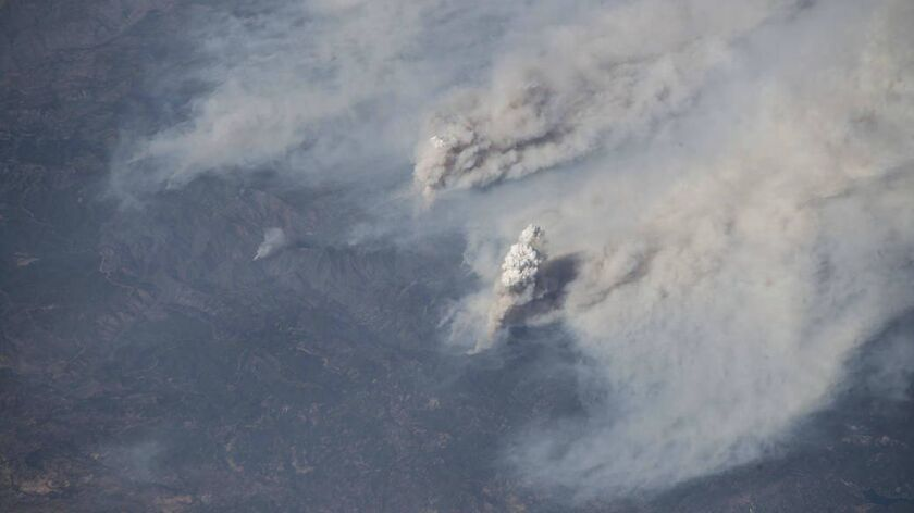 This image provided by NASA shows the California wildfires captured from the International Space Sta
