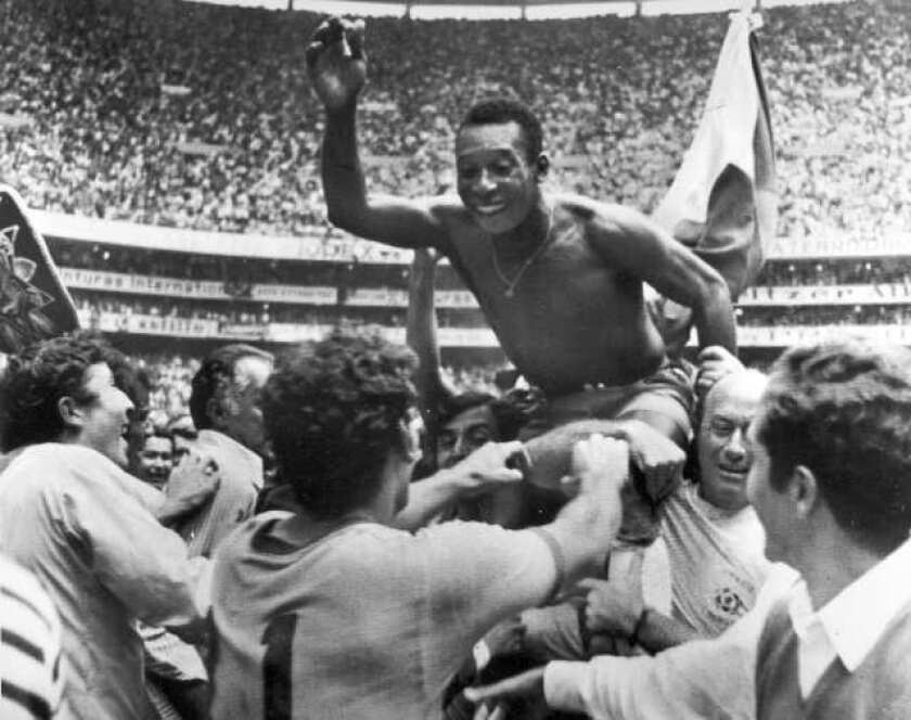 Pele gets a lift from teammates after Brazil defeated Italy, 4-1, to win the 1970 World Cup.
