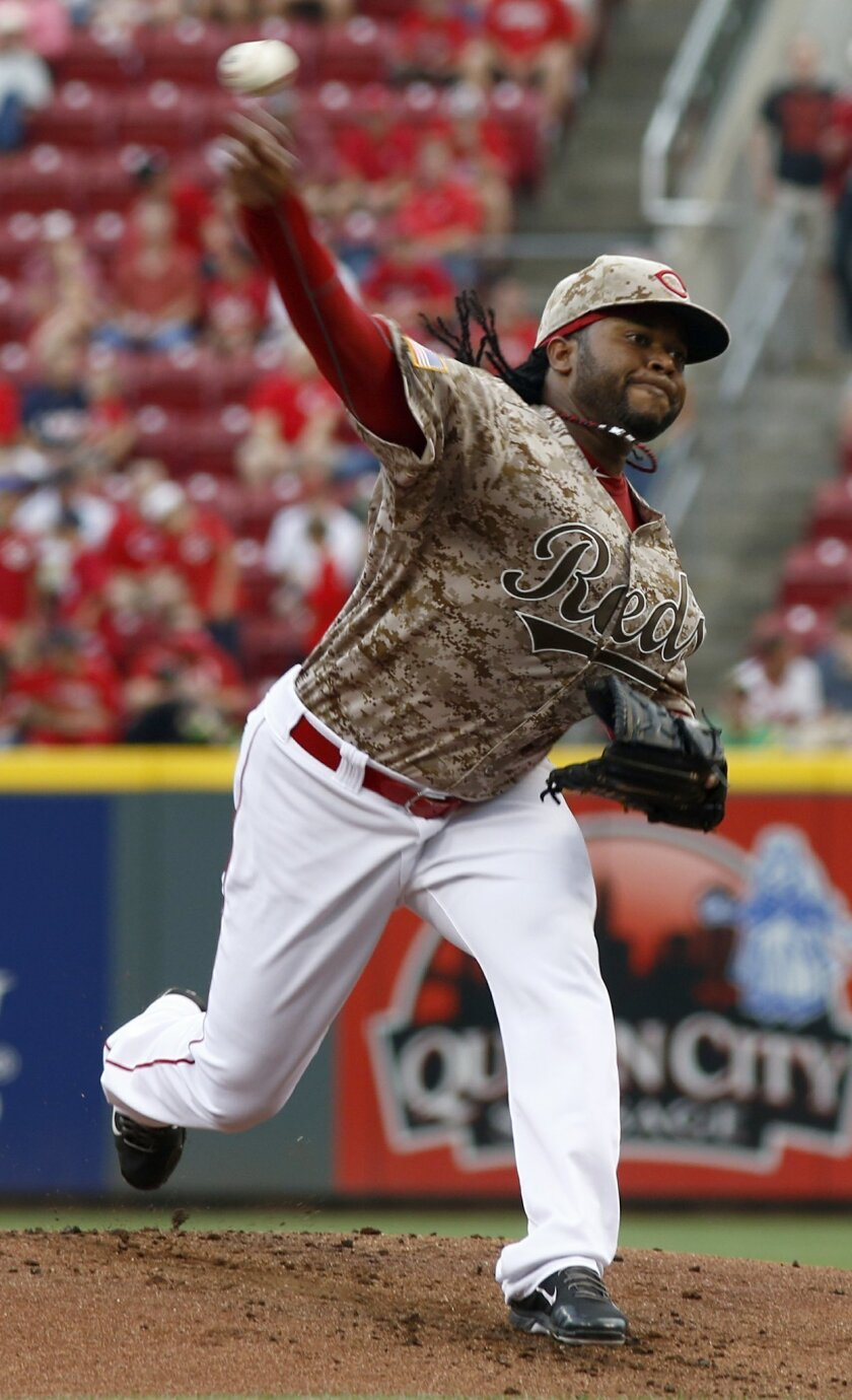 Cincinnati Reds starting pitcher Johnny Cueto throws against the Los Angeles Dodgers during the first inning of a baseball game, Wednesday, June 11, 2014, in Cincinnati. (AP Photo/David Kohl)