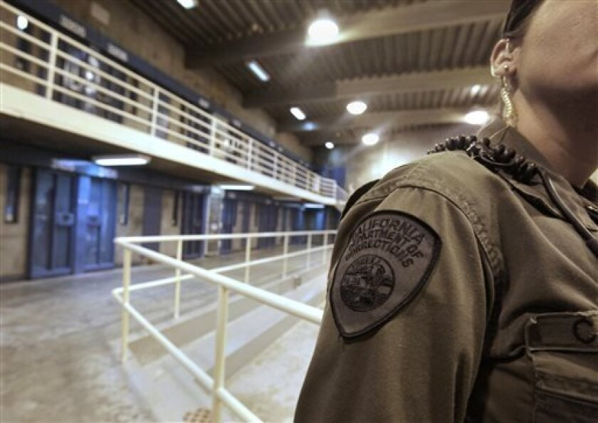 FILE -- In this Aug. 17, 2011 file photo,  a correctional officer is seen in one of the housing units at Pelican Bay State Prison near Crescent City, Calif. More than 30,000 of the 133,000 inmates in California prisons refused at least one meal, Monday July 8, 2013, in support of inmates held in so