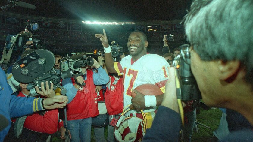 Washington Redskins quarterback Doug Williams walks off field after Redskins defeated the Denver Broncos 42-10 in the Super Bowl at San Diego Stadium