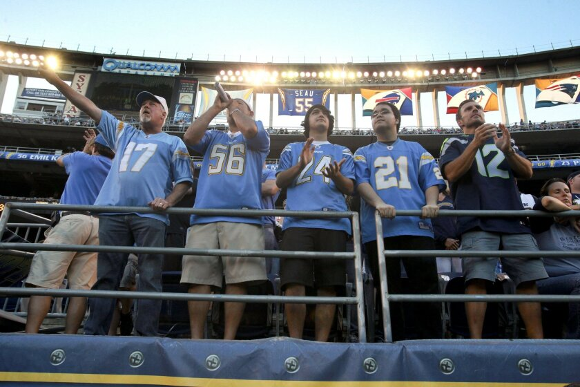 Chargers fans cheer on the team during the first quarter of a preseason game against the Seattle Seahawks at Qualcomm Stadium.