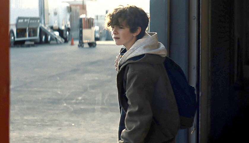 "Noah Jupe as Otis in ""Honey Boy,"" with a backpack slung over his right shoulder."
