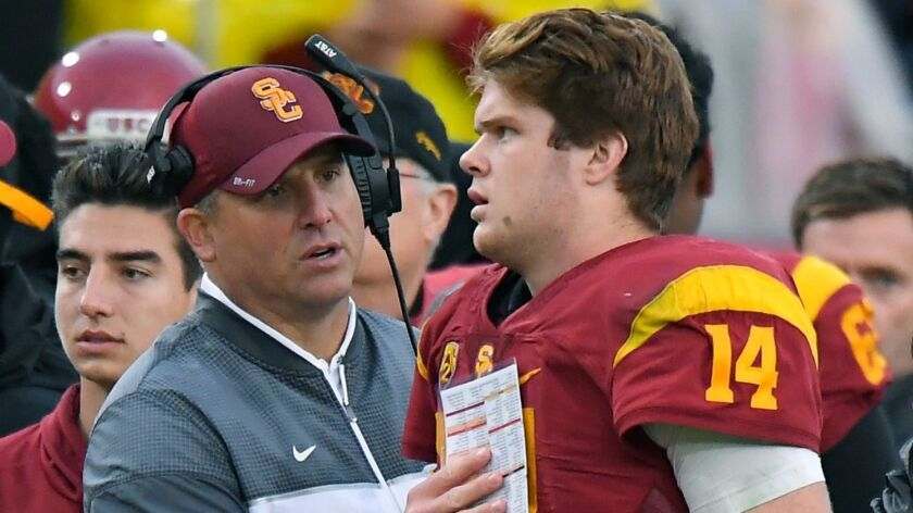 USC Coach Clay Helton, left, talks with quarterback Sam Darnold during the Trojans' game against Notre Dame on Nov. 26.
