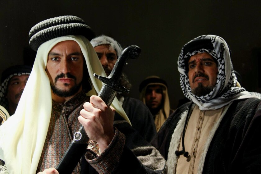 """This undated photo provided by office of Najdat Anzour shows a scene from a new movie titled """"King of the Sands"""" by leading Syrian producer Najdat Anzour. Syria is hitting back at Saudi Arabia for its support for rebels seeking to topple President Bashar Assad with an English-language movie that de"""