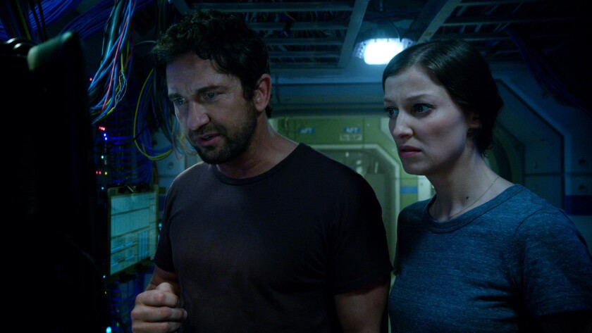 "Gerard Butler as Jake Lawson and Alexandra Maria Lara as Ute Fassbinder in Warner Bros. Pictures' and Skydance's suspense thriller ""Geostorm,"" which had a strong debut in China."