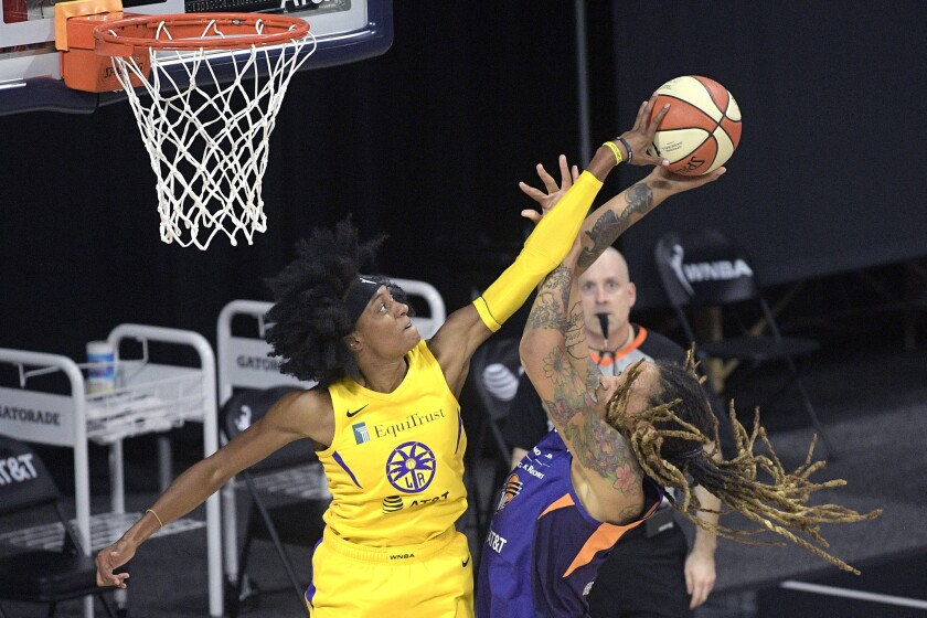 Sparks guard Brittney Sykes, left, blocks a shot by Mercury center Brittney Griner on July 25, 2020.
