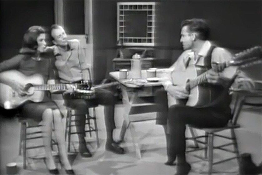 Pete Seeger, center, with June Carter and Johnny Cash.