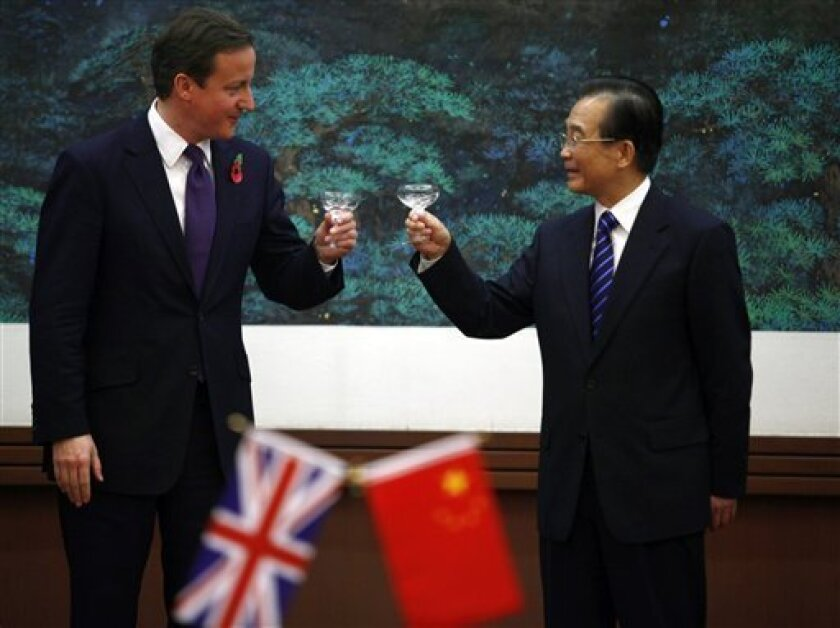 British Prime Minister David Cameron, left, and Chinese Premier Wen Jiabao toast a signing ceremony at the Great Hall of the People in Beijing, China on Tuesday, Nov. 9, 2010. (AP Photo/Petar Kujundzic, Pool)