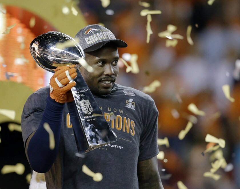 """FILE - In this Feb. 7, 2016, file photo, Denver Broncos' Von Miller holds the Lombardi Trophy after the NFL Super Bowl 50 football game against the Carolina Panthers in Santa Clara, Calif. Miller has agreed to a blockbuster $114.5 million contract with the Denver Broncos that includes $70 million in guarantees and makes him the highest-paid nonquarterback in NFL history. The Super Bowl MVP accepted the six-year offer two hours before Friday's, July 15, 2016 deadline, tweeting a photo of himself with the caption """"For Life."""" (AP Photo/Ben Margot, File)"""