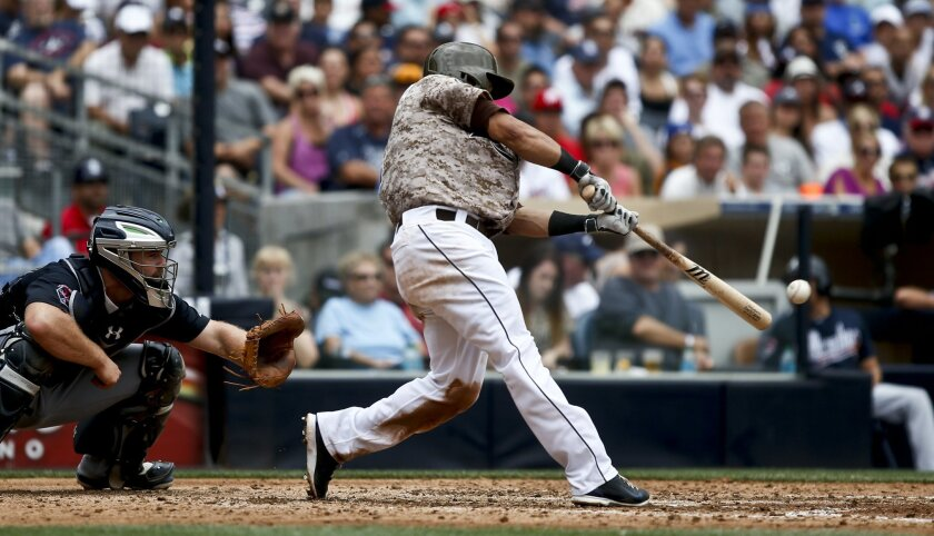 San Diego Padres' Everth Cabrera connects on a hard line drive that was caught in right field but allowed a run to score from third against the Atlanta Braves in the fourth inning of a baseball game Sunday, Aug. 3, 2014, in San Diego.  (AP Photo/Lenny Ignelzi)
