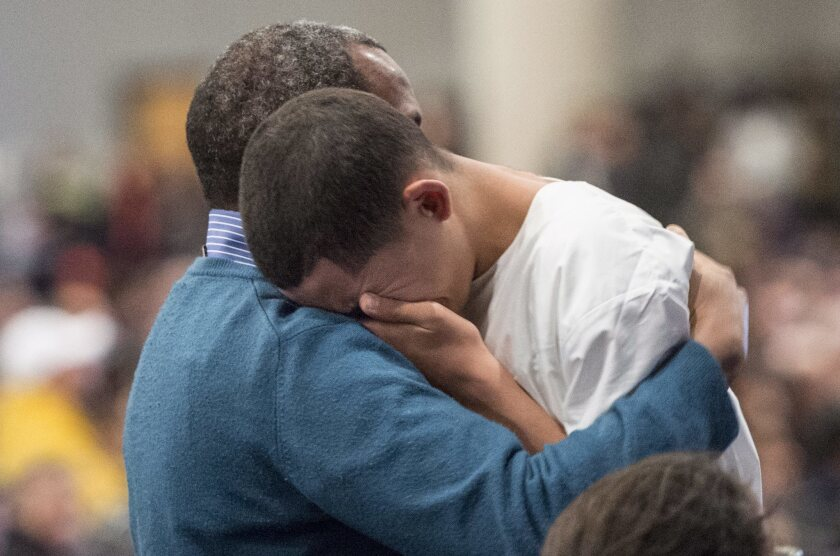 Ilies Soufiane, 15-year-old son of victim Azzeddine Soufiane, is consoled during a ceremony Friday for three of the six victims of the Quebec City mosque shooting.