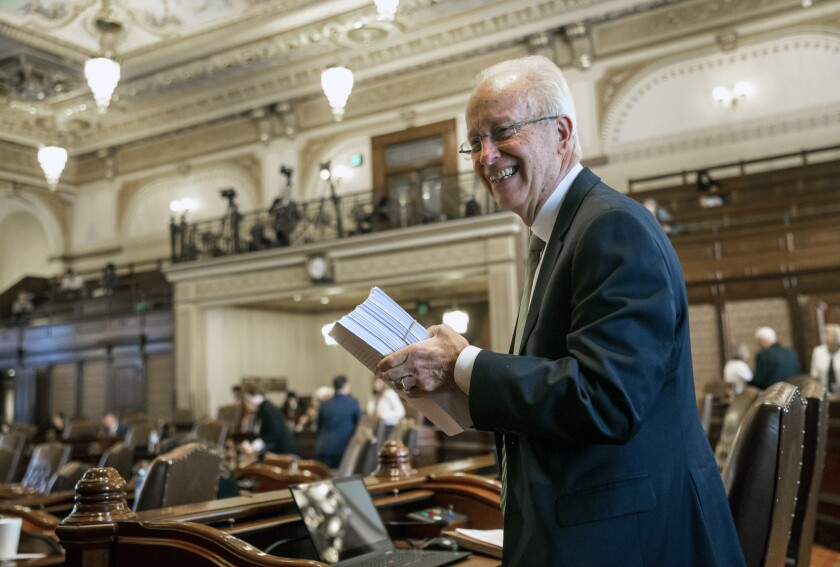FILE - In this June 2, 2019, file photo, former Illinois Sen. Terry Link, D-Vernon Hills, is seen at the Illinois State Capitol in Springfield, Ill. Link pleaded guilty Wednesday, Sept, 16, 2020 to tax evasion in federal court. The Democrat, who resigned last week, had been in office since 1997. He's the latest state legislator to be charged in the federal government's ongoing criminal investigations into public corruption. (Justin L. Fowler/The State Journal-Register via AP File)