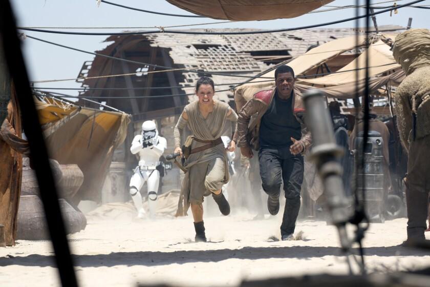 "Rey (Daisy Ridley) and Finn (John Boyega) in ""Star Wars: The Force Awakens."""