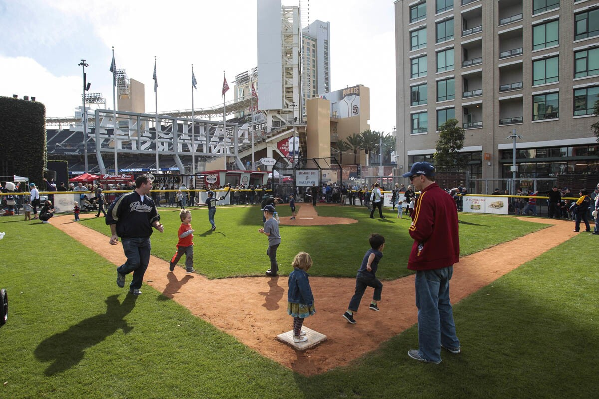 SAN DIEGO , February 11, 2017 | Kids and adults run the bases at the Bumble Bee Ballpark during the Celebrate San Diego Rally at Petco Park in San Diego on Saturday. | Photo by Hayne Palmour IV/San Diego Union-Tribune/Mandatory Credit: HAYNE PALMOUR IV/SAN DIEGO UNION-TRIBUNE/ZUMA PRESS San Diego Union-Tribune Photo by Hayne Palmour IV copyright 2016