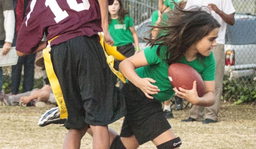 Ella Wood, the lone girl on the Sequoyah School flag football team, plays linebacker and tight end. Her school was forced to forfeit all its games for including a girl on the roster. On the field, they beat every team they faced.