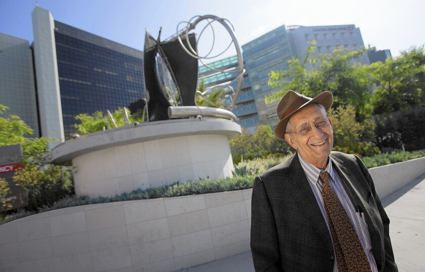"""Artist Frank Stella stands beside his scuplture """"Adjoeman,"""" which was created in 2004. The sculpture has been installed at the intersection of Beverly and San Vicente boulevards, in front of Cedars-Sinai Medical Center."""