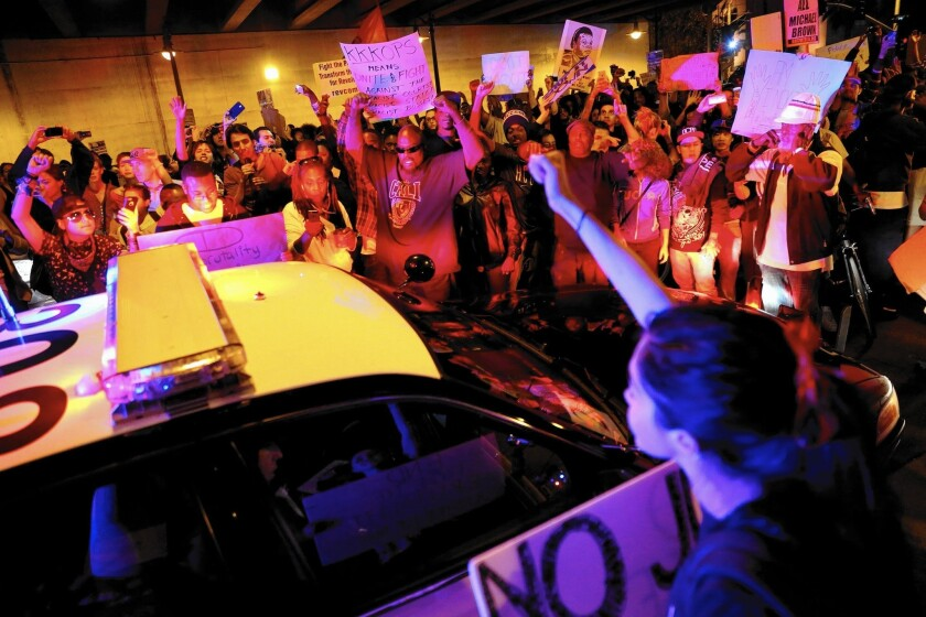 Protesters surround LAPD vehicle