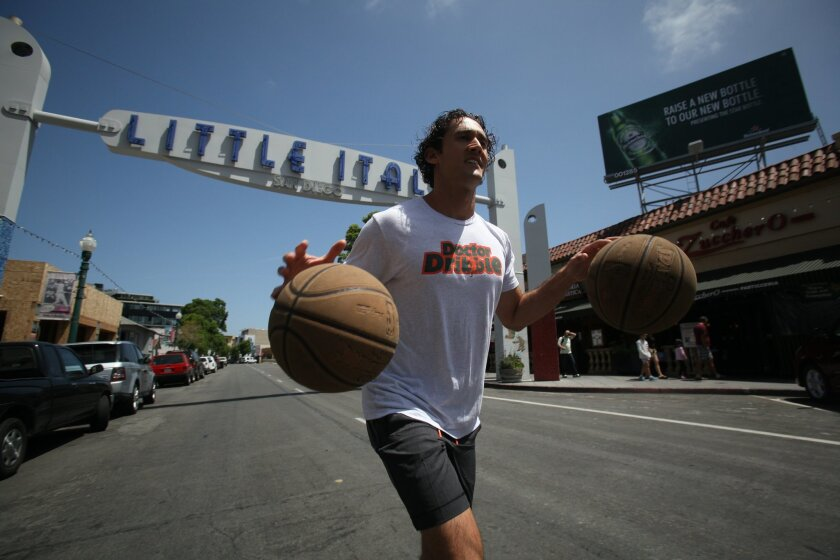 Darren Weissman of Miami will be dribbling basketballs during the Rock 'n' Roll Marathon in town on Sunday. His goal: A world record.