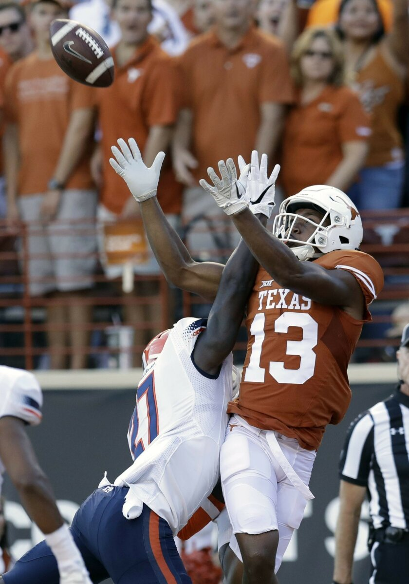 Texas wide receiver Jerrod Heard (13) pulls in a pass over UTEP defensive back Devin Cockrell (27) for a touchdown during the first half of a NCAA college football game, Saturday, Sept. 10, 2016, in Austin. (AP Photo/Eric Gay)