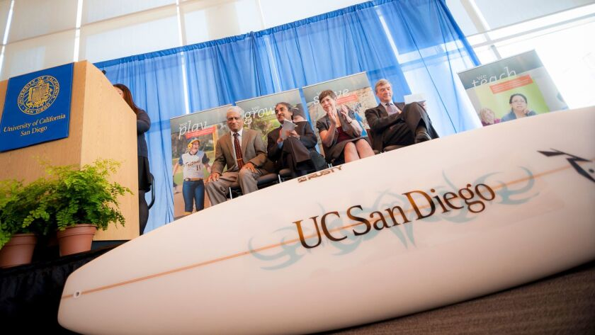 Students presented Pradeep Khosla with a surfboard when he became chancellor in 2012. He's yet to us