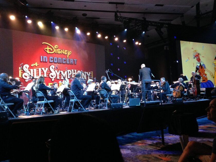 Steven Allen Fox conducts a 32-piece orchestra in the premier of the Silly Symphony Celebration concert at the D23 Expo at the Anaheim Convention Center. Vintage Disney cartoons from the 1930s were projected as the orchestra performed the original score.