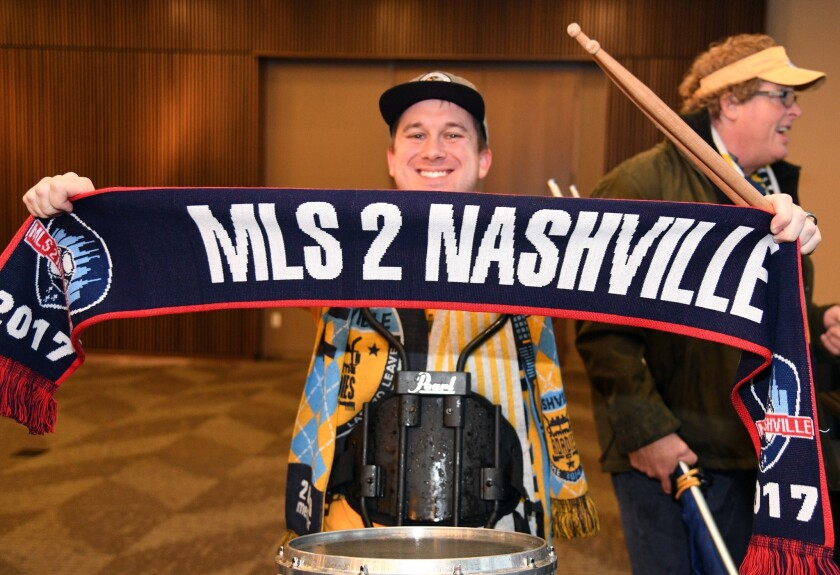 Dec 20, 2017; Nashville, TN, USA; A member of the Nashville Roadies poses with a scarf before a press conference to announce Nashville as a new MLS expansion team at the Country Music Hall of Fame.