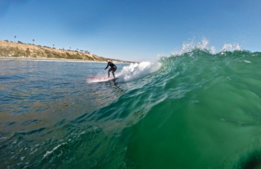 Wednesday's offshore winds help produce smooth waves at Encinitas.