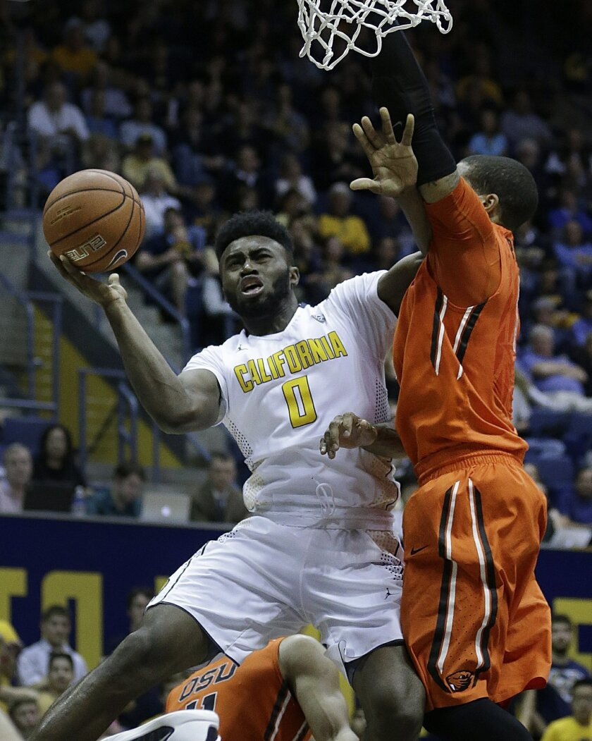 RETRANSMISSION TO CORRECT ID TO GARY PAYTON II FROM MAURICE O'FIELD - California's Jaylen Brown, left, shoots against Oregon State's Gary Payton II in the second half of an NCAA college basketball game Saturday, Feb. 13, 2016, in Berkeley, Calif. (AP Photo/Ben Margot)