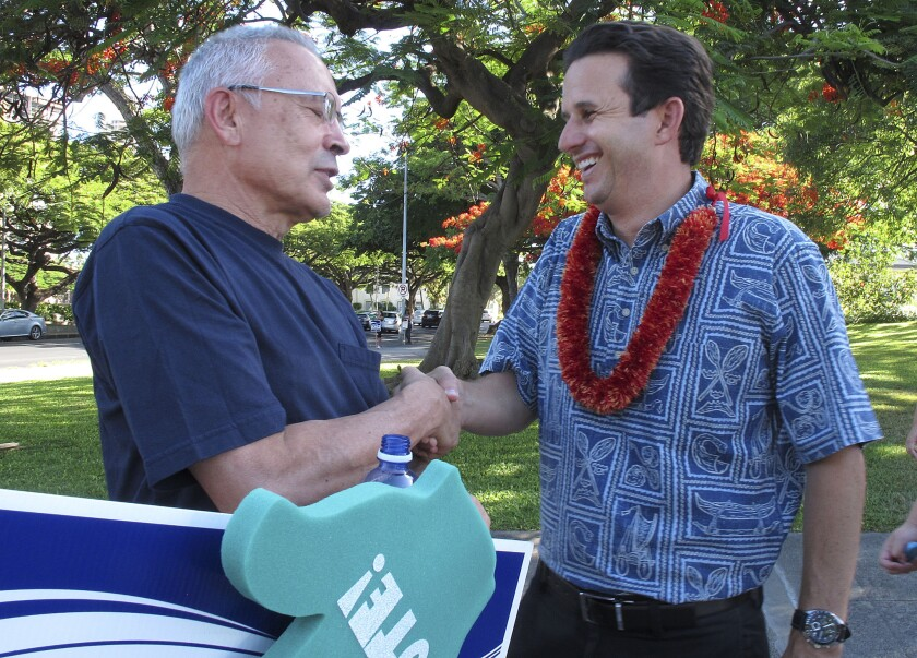 U.S. Sen. Brian Schatz, right, greets a supporter during a campaign event in Honolulu. Schatz faces a primary challenge from Rep. Colleen Hanabusa.