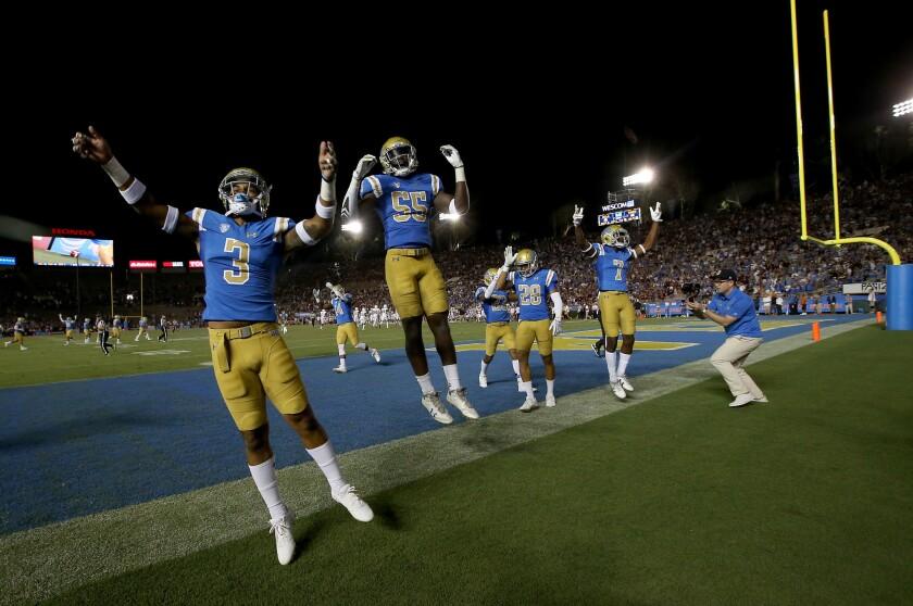 PASADENA, CALIF. - SEP. 3, 2017. Members of UCLA football team begin celebrating their 45-44 comeba