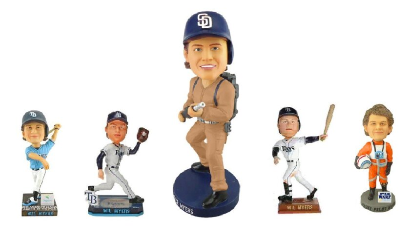 Padres first baseman Wil Myers gets his first bobblehead (center) since coming to San Diego, but he had several others put out while a member of the Tampa Bay organization.