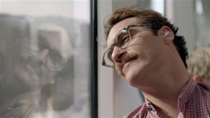 """This image released by Warner Bros. Pictures shows Joaquin Phoenix in a scene from the Spike Jonze film, """"Her."""" The film will be shown at the closing night presentation for the 51st New York Film Festival. The festival opens Sept. 27 and runs through Oct. 13. (AP Photo/ Warner Bros. Pictures)"""