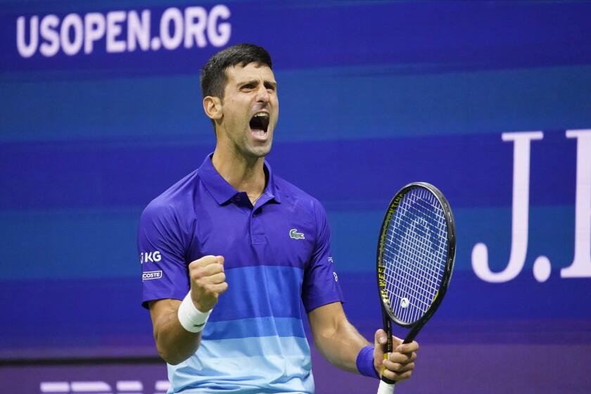 Novak Djokovic reacts after winning a point against Alexander Zverev during their U.S. Open semifinal Friday night.