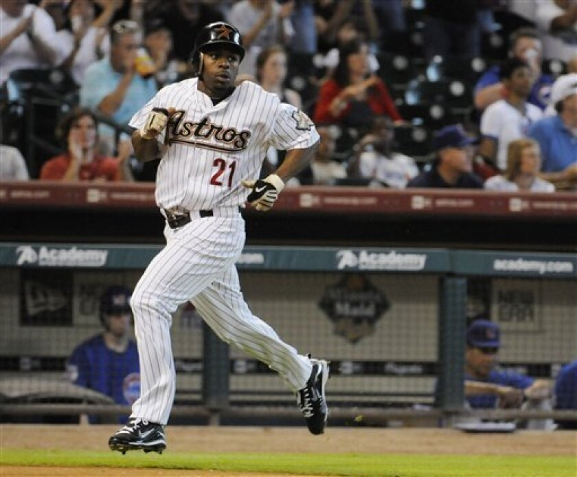Houston Astros' Michael Bourn heads for home plate to score from second base on a Lance Berkman single in the first inning of a baseball game against the Chicago Cubs Friday, June 4, 2010 in Houston. (AP Photo/Pat Sullivan)