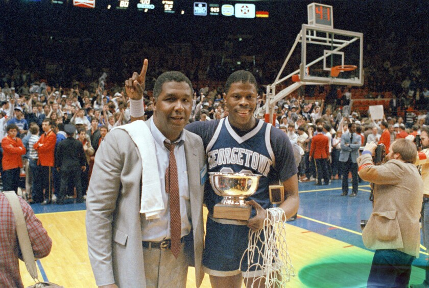 Georgetown coach John Thompson with player Patrick Ewing after the Hoyas won the 1985 NCAA championship.