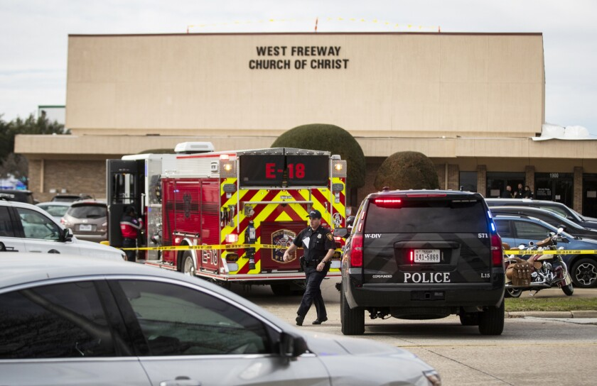 Police and fire personnel surround at the of the shooting at West Freeway Church of Christ in White Settlement, Texas, on Sunday.