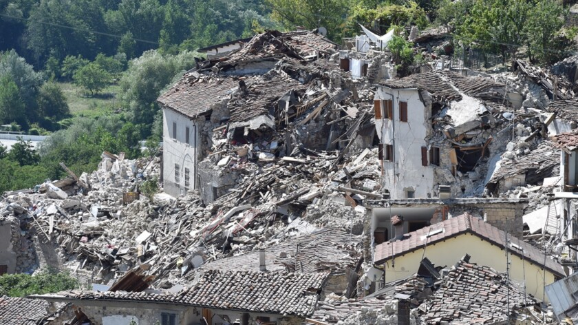 Buildings in Pescara del Tronto were reduced to a pile of rubble by the earthquake as the search for survivors continues.