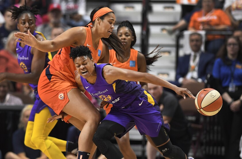 Connecticut's Brionna Jones, left, fouls Sparks guard Alana Beard.