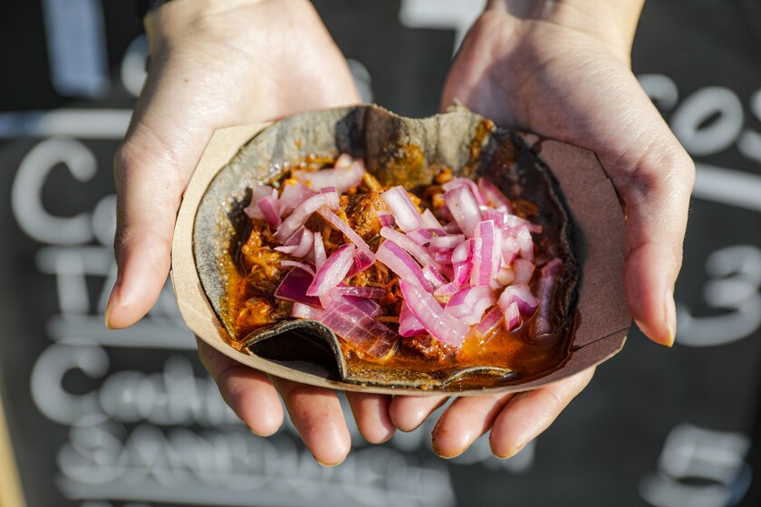 A cochinita pibil taco in a blue corn tortilla from Tania's Tacos in Echo Park.