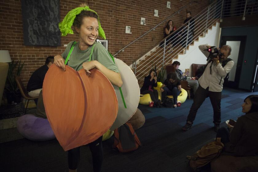 Alli McKee dressed as an old Apple peach emoji costume in protest of the company's recent move to make its peach look less like a posterior. She wore it to the Emojicon launch party at Covo a co-working space in San Francisco, CA, USA.