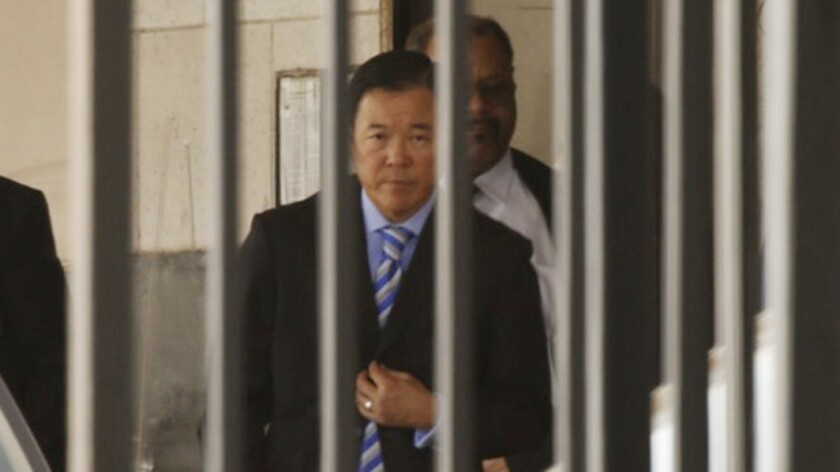 Paul Tanaka leaves court after being sentenced Monday to five years in prison.