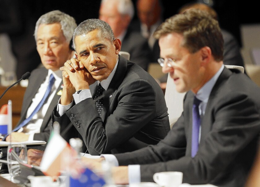 President Obama listens to Dutch Prime Minister Mark Rutte at the closing session of the nuclear security summit in The Hague. The president is to give a speech in Brussels on Wednesday.