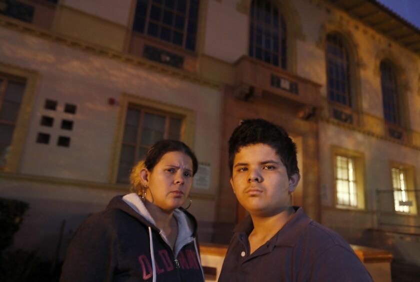 LOS ANGELES, CALIF. - JAN. 8, 2019. Maria Espinoza, 36, left, picks up her 12-year-old son Michael