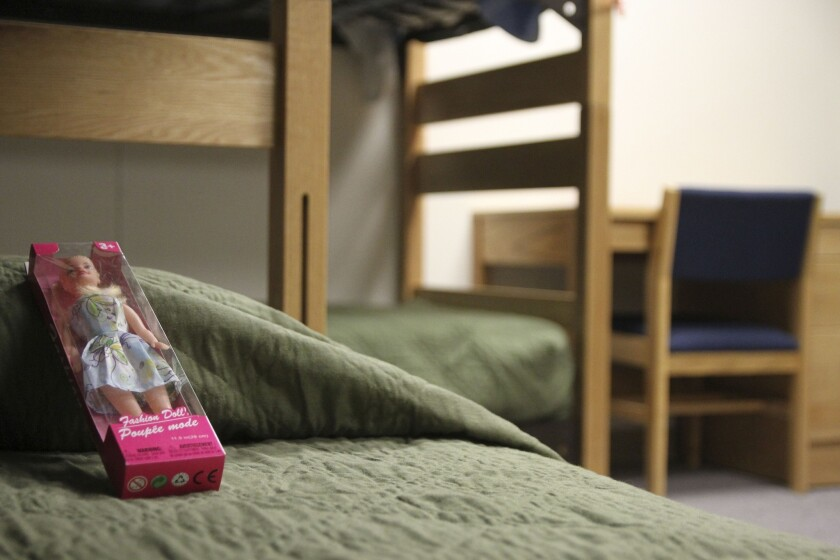 A doll rests on a bed at an immigration detention center in Artesia, N.M.