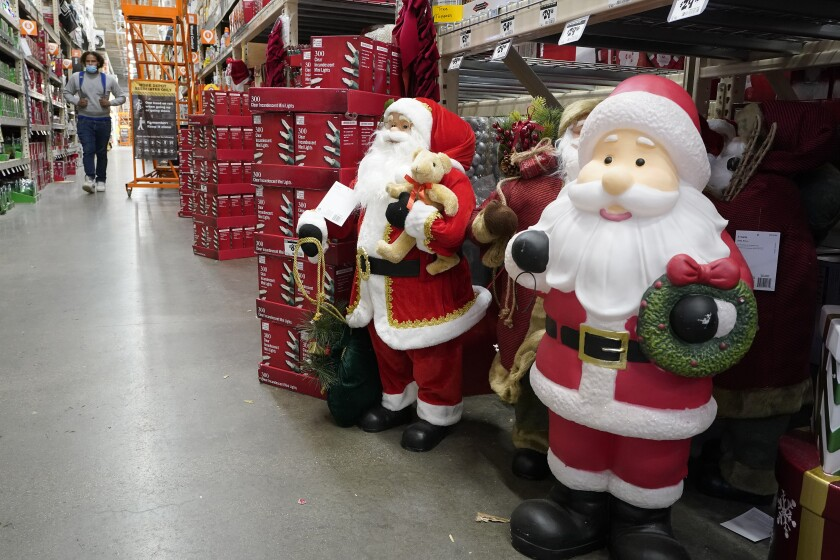 Santa Claus figures at a Home Depot store in Boston