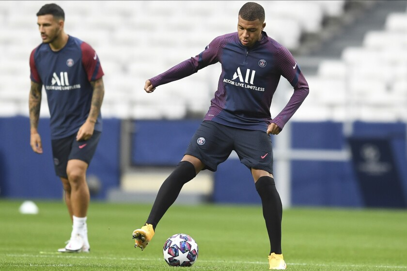 PSG's Kylian Mbappe controls the ball during a training session at the Luz stadium in Lisbon, Tuesday Aug. 11, 2020. PSG will play Atalanta in a Champions League quarterfinals soccer match on Wednesday. (David Ramos/Pool via AP)
